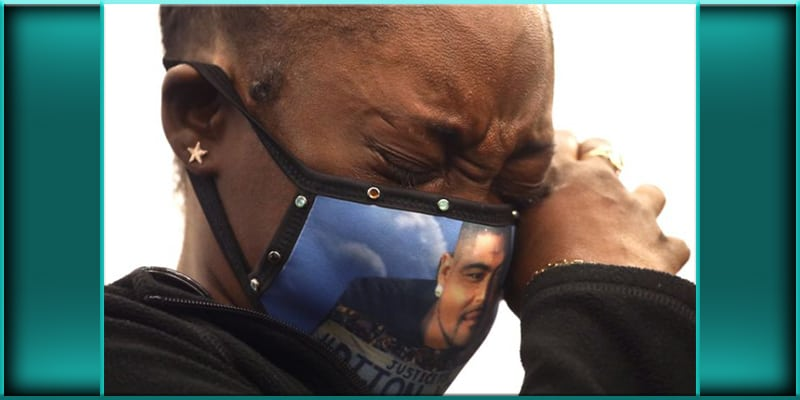 Dijon Kizzee's Kizzee cousin Shaneika Hall crying while wearing mask at Tuesday conference