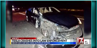 Tesla on autopilot crashes crashed smashes smashed into police sheriff's patrol car vehicle Raleigh North Carolina