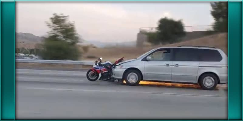 Corona California minivan van driver struck collides with motorcyclist drags it in front of vehicle on freeway high speeds
