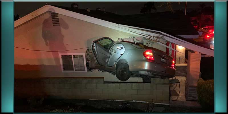car vehicle smashes crashes embeds embedded itself into Rowland Heights California home house