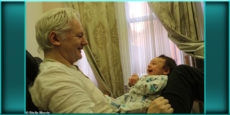 Julian Assange with his baby son Gabriel