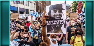 Justice for Jacob Blake sign Kenosha Wisconsin police shooting protests