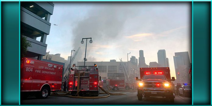 Firefighters working at the scene of massive downtown Los Angeles building structure fire explosion May 16 2020