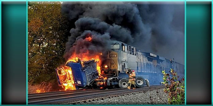 Pendleton Indiana freight train collides crashes crashed crashing slams slammed slamming into semi truck tractor trailer